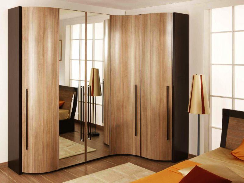 Дизайн углового шкафа в спальню - фото дизайн интерьера.